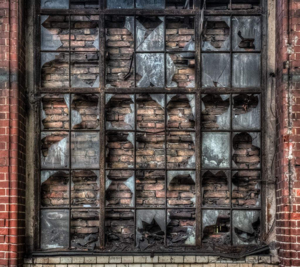 Window towards a brick wall in the northern power house of Beelitz Heilstätten