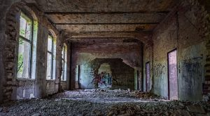 Multiple wall breakthroughs and lots of debris in a Beelitz hospital building