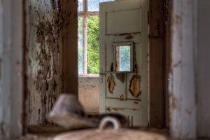 A shoe in a hatch of a door