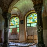 A ruined bathroom with colored windows in Beelitz Heilstätten