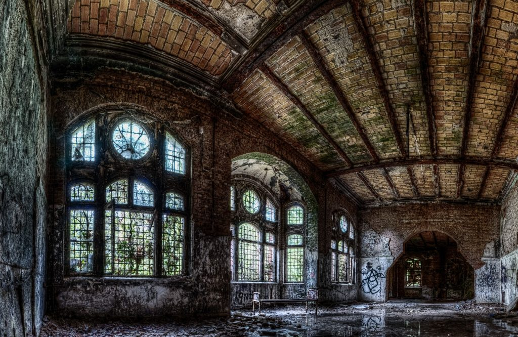 Panorama of a bed in a water pond inside the ruins of a Beelitz hospital building