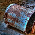 A rusty bin in debris is the only furniture left in the basement of the Beelitz surgery