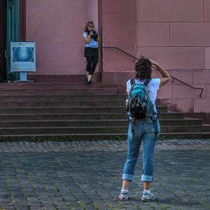 Students taking photos of other students in front of St. Ludwig church, Darmstadt