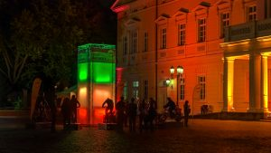 Humans try to light up the colored tower with the generator bikes